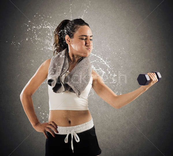 Sweat and toil at gym Stock photo © alphaspirit
