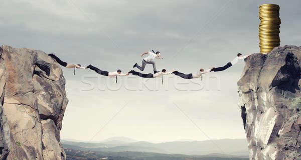 бизнесменов поддержки моста деньги форме Сток-фото © alphaspirit