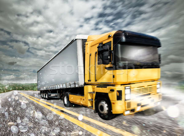 Transporter truck on a highway during storm Stock photo © alphaspirit