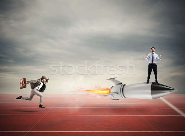 Winner businessman over a fast rocket. Concept of business competition Stock photo © alphaspirit