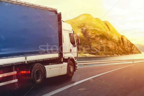 Truck run fast on the highway to deliver Stock photo © alphaspirit