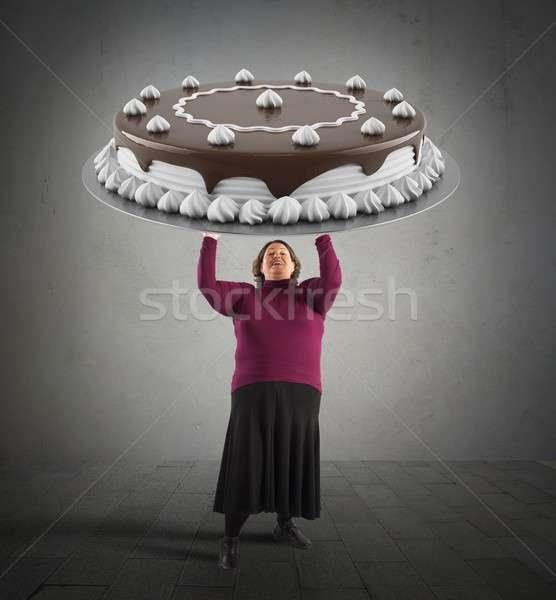 Nagy csokoládés sütemény kövér nő tart étel Stock fotó © alphaspirit