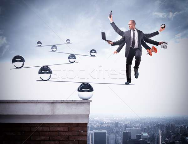 Equilibrio multitasking imprenditore bilanciamento ferro Foto d'archivio © alphaspirit