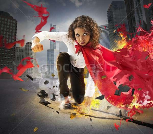 Déterminé héros femme d'affaires poing asphalte femme Photo stock © alphaspirit