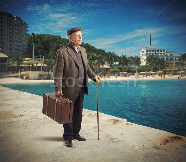 Pensione uomo vacanze spiaggia città piedi Foto d'archivio © alphaspirit