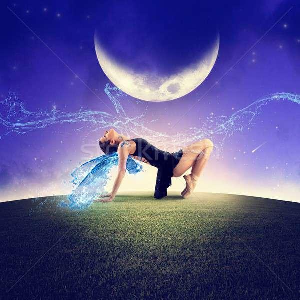 Danse lune danseur ailes femme danse Photo stock © alphaspirit