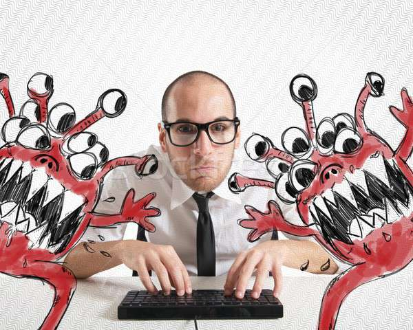 Businessman attempts to eradicate computer from viruses Stock photo © alphaspirit