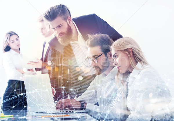 Businessman in office connected on internet network with network effects. concept of startup company Stock photo © alphaspirit