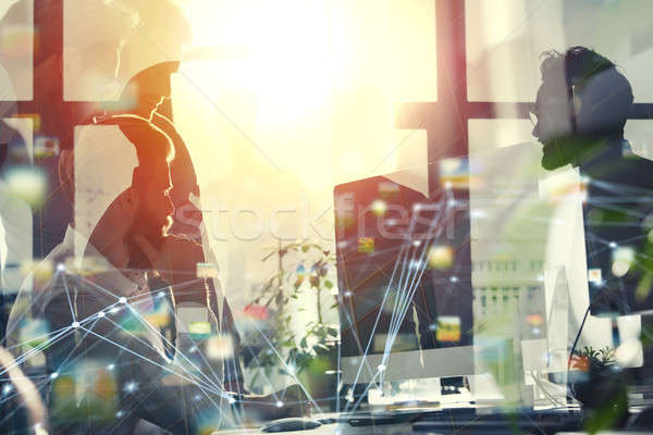 Business people in office connected on internet network. concept of startup company. double exposure Stock photo © alphaspirit