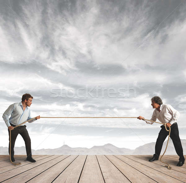 Businessman and  rope challenge Stock photo © alphaspirit