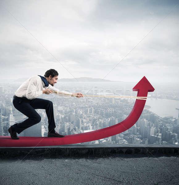 Empresario estadística esfuerzo flecha cuerda rascacielos Foto stock © alphaspirit