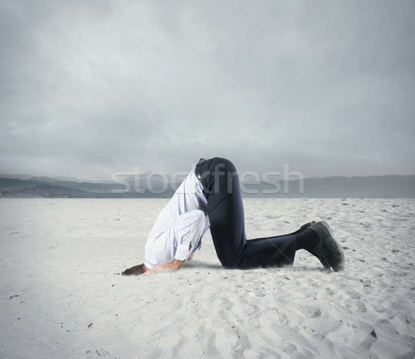 Fear of crisis with businessman like an ostrich Stock photo © alphaspirit