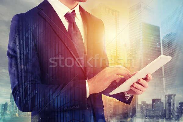 Businessman shares document with tablet. Internet concept Stock photo © alphaspirit
