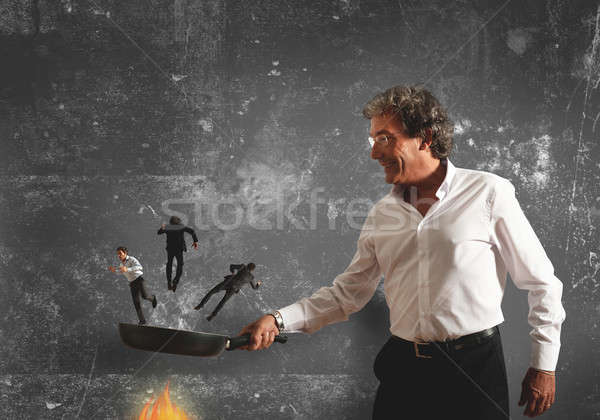 Concept of burning in the pan the competitor Stock photo © alphaspirit
