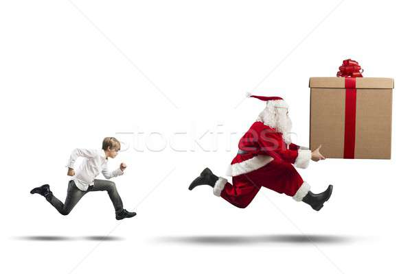 Child wants a present from Santa Claus Stock photo © alphaspirit