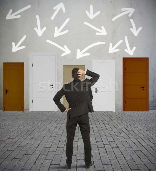 Verward zakenman verschillend deuren man werk Stockfoto © alphaspirit