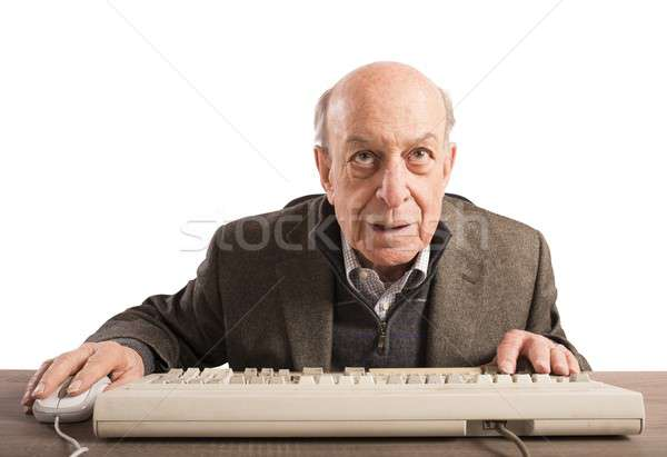 Ancianos nerd trabajo vintage teclado portátil Foto stock © alphaspirit