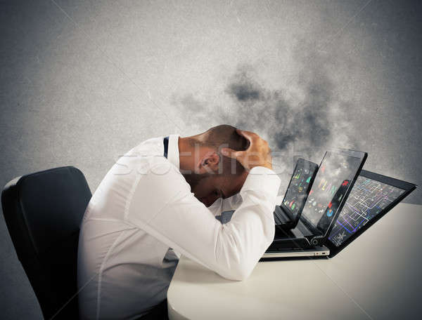 Businessman overworked worn computers Stock photo © alphaspirit