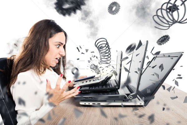 Stock photo: Businesswoman overworked worn computers