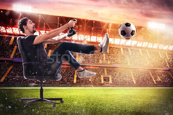 Valósághű futball videojáték fiú botkormány futball Stock fotó © alphaspirit