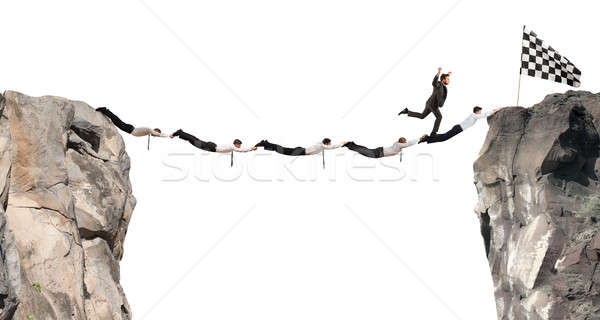 Zakenlieden ondersteuning brug vlag prestatie business Stockfoto © alphaspirit