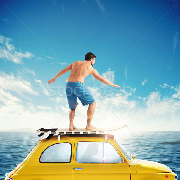 Old car with a surfing boy over the roof. 3D rendering Stock photo © alphaspirit