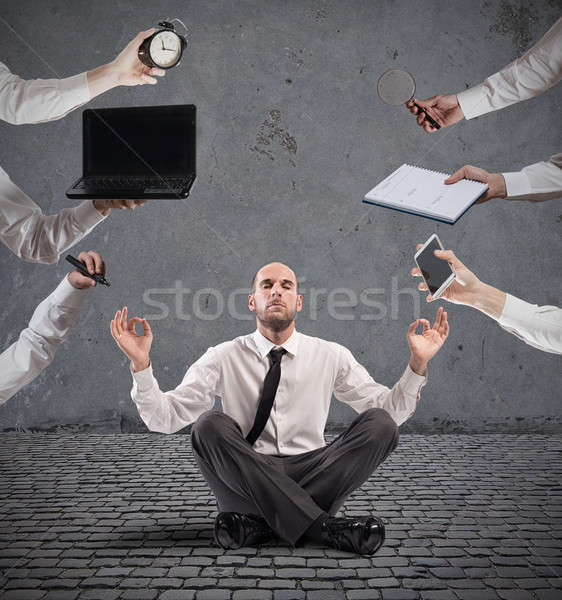 Relaxed businessman that does yoga during the work Stock photo © alphaspirit