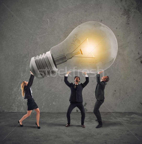 Business people hold a light bulb. concept of new idea and company startup Stock photo © alphaspirit
