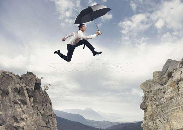 Foto stock: Empresário · saltando · montanhas · negócio · homem · saltar