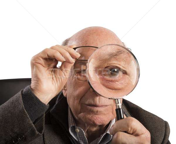 Stock photo: Elder magnifies