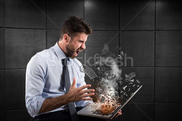 Stres hüsran bilgisayar işadamı yangın dizüstü bilgisayar Stok fotoğraf © alphaspirit