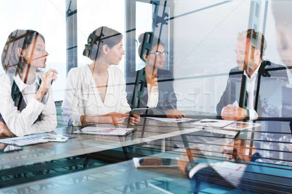 Team of businessmen work together in office. Concept of teamwork and partnership Stock photo © alphaspirit