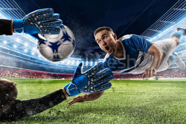 Goalkeeper catches the ball in the stadium Stock photo © alphaspirit