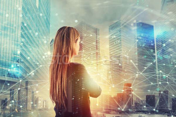 Businesswoman looks far for the future with internet network effect Stock photo © alphaspirit