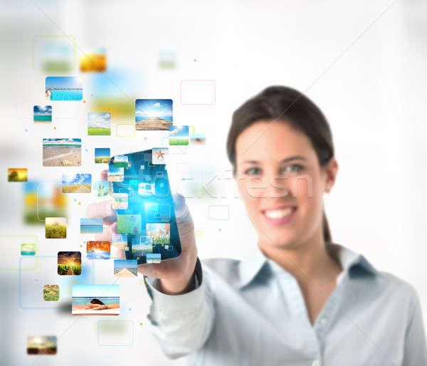 ストリーミング 携帯電話 ビジネス 少女 電話 技術 ストックフォト © alphaspirit