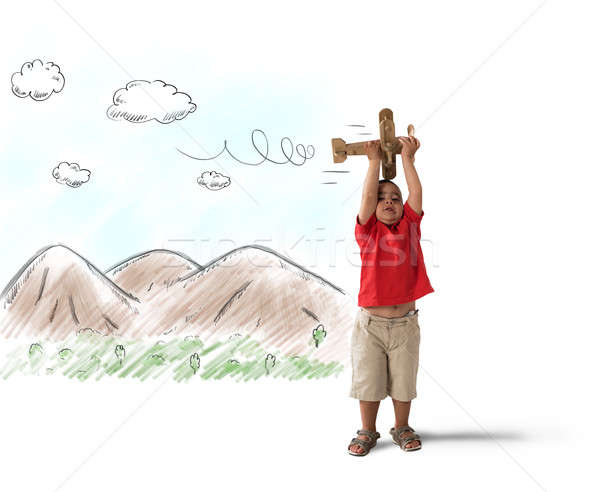Child playing with wooden plane Stock photo © alphaspirit