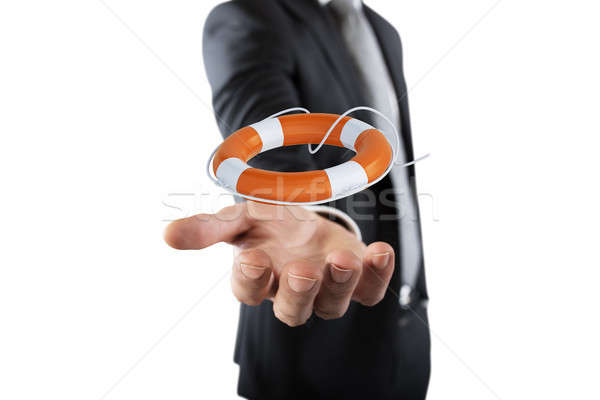 Businessman that hold a lifebelt. Concept of insurance and help in your business Stock photo © alphaspirit