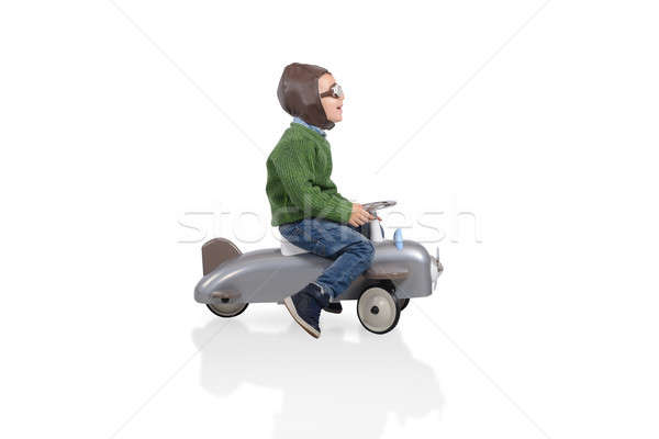 Kid plays with a small arplane. Isolated on white background Stock photo © alphaspirit
