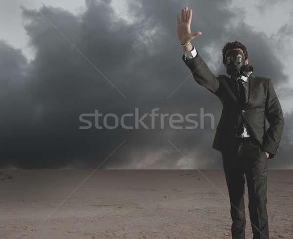 Businessman indicates radiation  Stock photo © alphaspirit