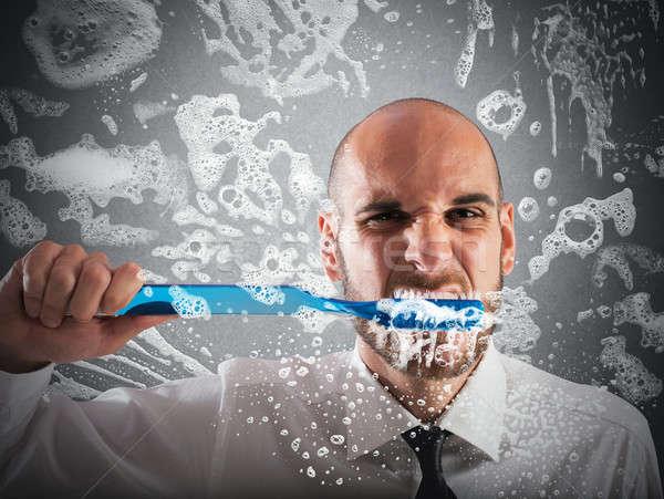 Grande cepillo de dientes hombre belleza dientes Foto stock © alphaspirit