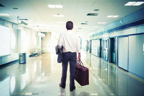 Businessman in airport ready to travel Stock photo © alphaspirit