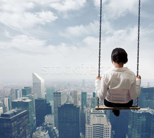 Businesswoman on a swing Stock photo © alphaspirit