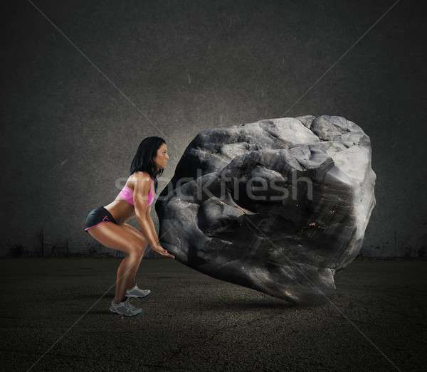 Power of muscular woman Stock photo © alphaspirit