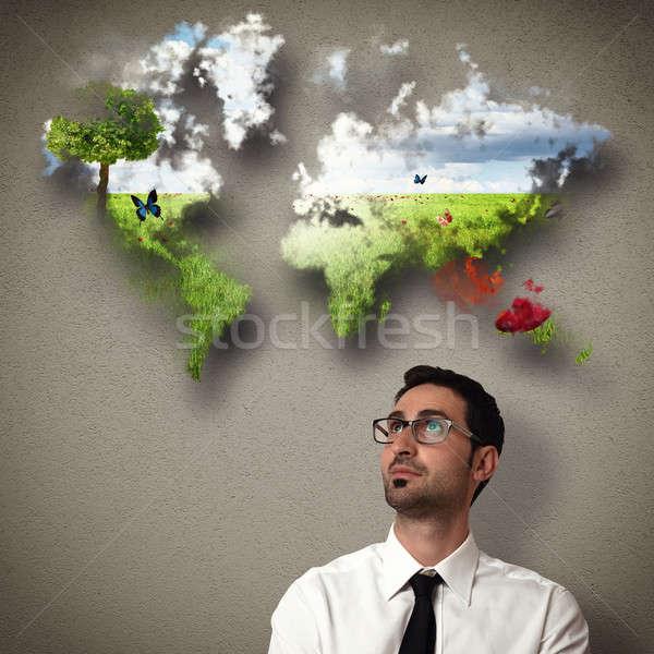 Businessman imagines a clean world Stock photo © alphaspirit