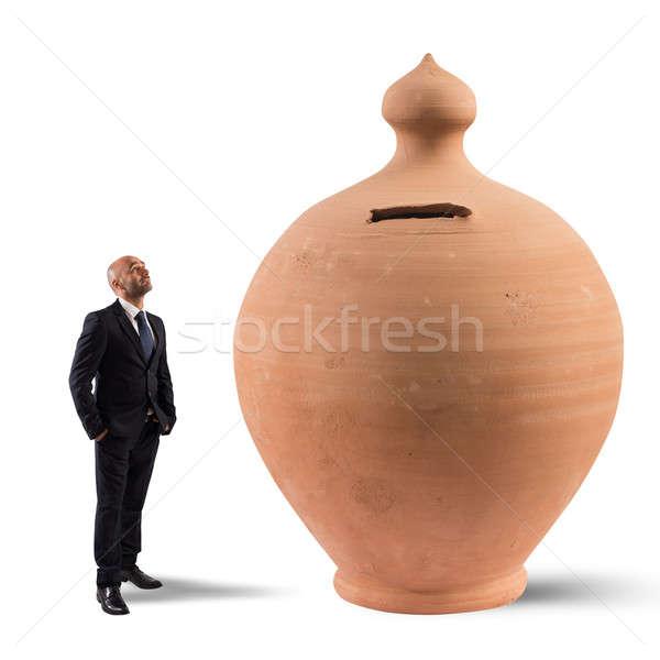 満足した 貯蓄 ビジネスマン ルックス ビッグ お金 ストックフォト © alphaspirit
