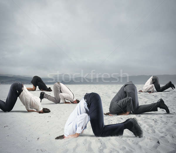 Fear of crisis with businesspeople like an ostrich Stock photo © alphaspirit