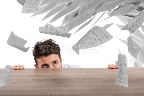 Businessman afraid under the desk. concept of overwork Stock photo © alphaspirit