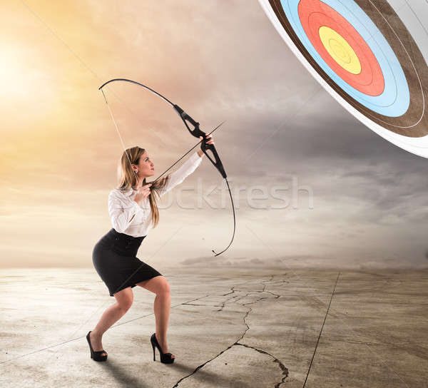 Businesswoman point to success in business with arrow Stock photo © alphaspirit
