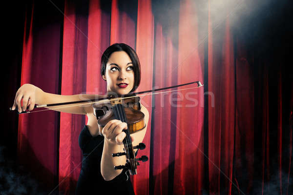 Charming violinist Stock photo © alphaspirit