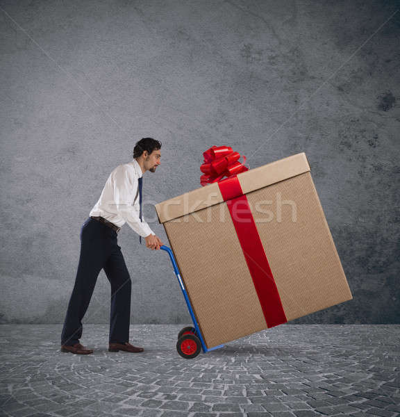 Entrega navidad regalos empresario pesado Foto stock © alphaspirit